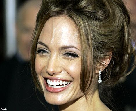 angelina jolie plastic surgery photos. Reporters slammed Angelina