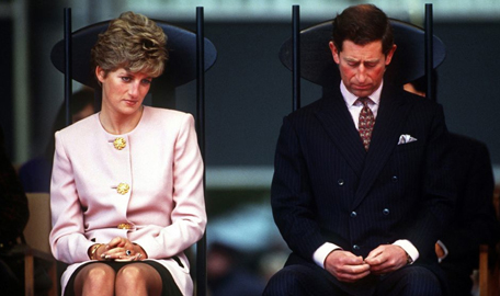 Glum looking princess diana and prince charles whose marriage was